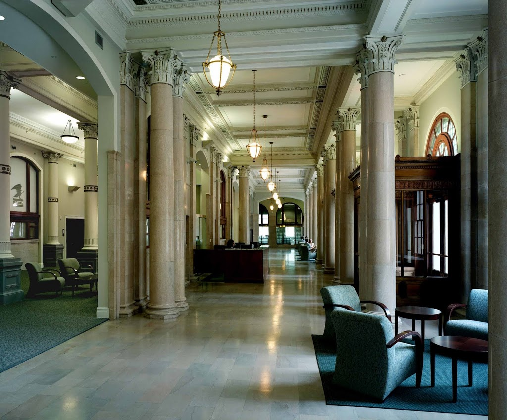 The marble lobby with its ornate corinthian columns and richly detailed ceilings was restored and now serves as the reception, student lounge area, and event space for the school.